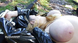 Huge breasts tied up in the forest and the train line