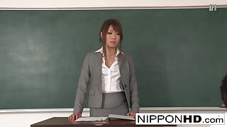 Asian teacher jerks and gives a blowjob in class