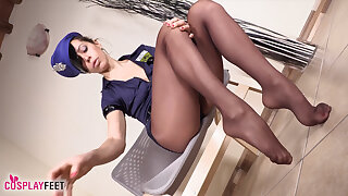 Sexy cops takes boots off and shows feet in stocking