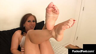 Big Calves Crystal Coat Jacks Off Dick With Her Humungous Feet!