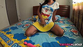 Asian girl sucking plaything