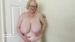 Sally ties her boobs and plays with dildo