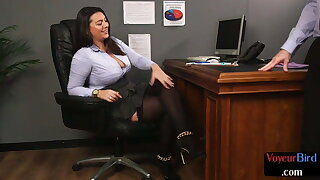 Busty office voyeur taunting subject's dick with her feet