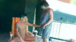 Crazy Stepson Entices German Mother to Fuck on Balcony