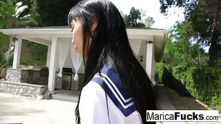 Schoolgirl Marica walks through the house